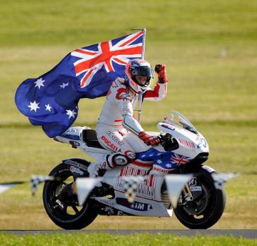 Casey Stoner proudly Australian with flag after winning the GP
