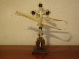 A crucifix with palm leaves.