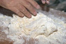 Pour the flour on a wooden plank and start working the dough