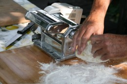 Cut a piece of dough, press it with your hand and fingers until it becomes a 2-3 cm thick sheet, then pass it in the pasta machine with the rollers set at max thickness