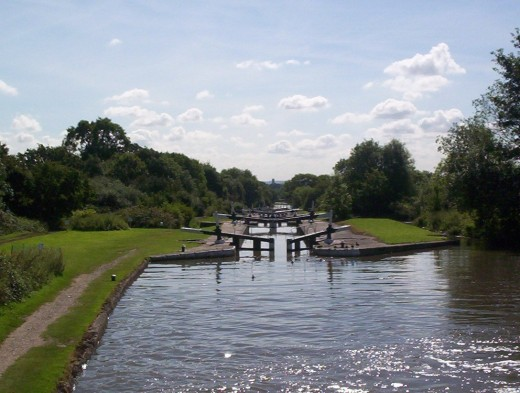 Looking down a flight of broad locks, with double gates at both ends of each lock