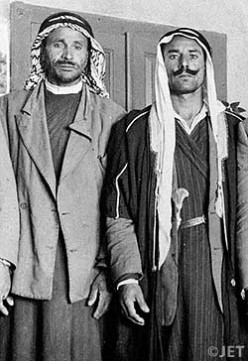Muhammed edh-Dhib and Ahmed Mohammed, two Bedouin shepherds of the Ta'amireh tribe.