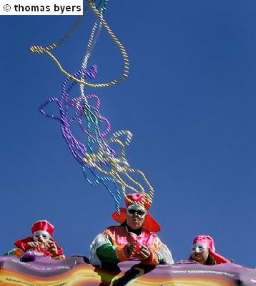 Krewe Members Throwing Beads From A Float