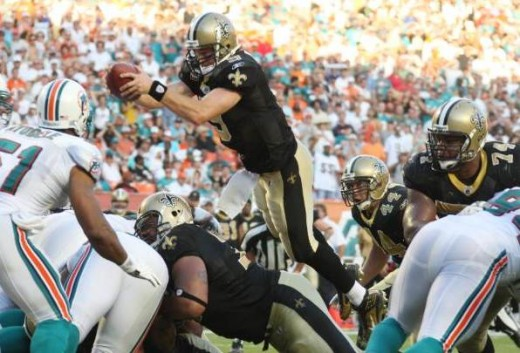 New Orleans quarterback Drew Brees (9) goes over his linesmen to score a touchdown from within the one yard line Sunday, Oct. 25, 2009 in Miami as they play the Miami Dolphins. (AP Photo/J Pat Carter)