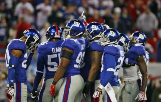 New York Giants defense huddles during the first quarter an NFL football game against the the Arizona Cardinals Sunday, Oct. 25, 2009, in East Rutherford, N.J. (AP Photo/Tim Larsen)