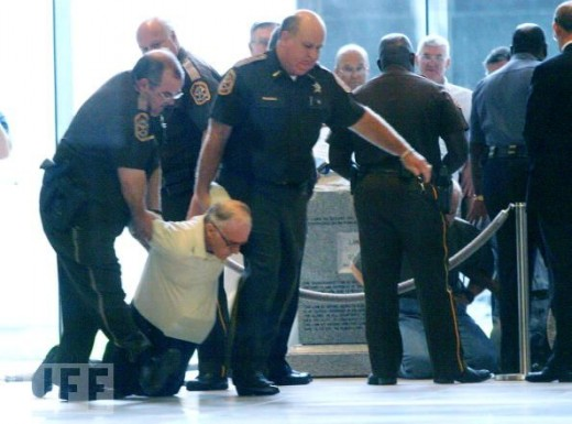 Moore's refusal to remove the commandments encourages other Americans to stand for the acknowledgment of God in public places. Here, a man who is trying to stop the removal of the monument is dragged away.