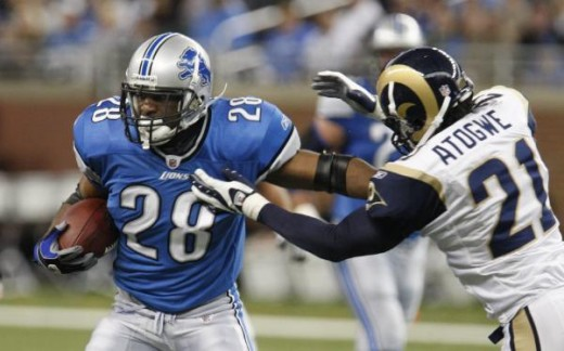 St. Louis Rams safety Oshiomogho Atogwe (21) stops Detroit Lions running back Maurice Morris (28) during the second quarter of an NFL football game at Ford Field in Detroit, Sunday, Nov. 1, 2009. (AP Photo/Carlos Osorio)