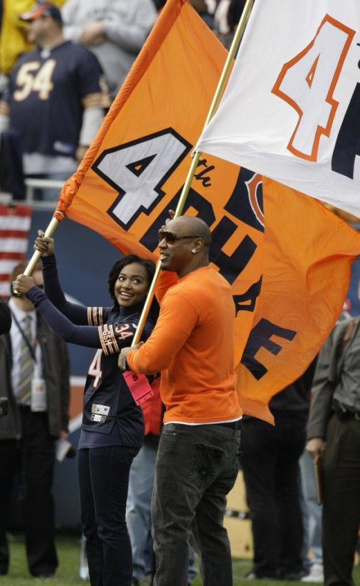 Jarrett and Brittney Payton, son and daughter of former Chicago Bears great Walter Payton, wave giant flags during pregame ceremonies before an an NFL football game between the Bears and Cleveland Browns in Chicago, Sunday, Nov. 1, 2009. The game was