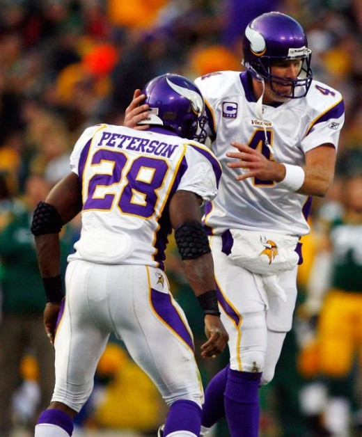Minnesota Vikings quarterback Brett Favre (4) celebrates with running back Adrian Peterson (28) after scoring a touchdown against the Green Bay Packers on Sunday, November 1, 2009. (Ben Liebenberg/NFL.com)