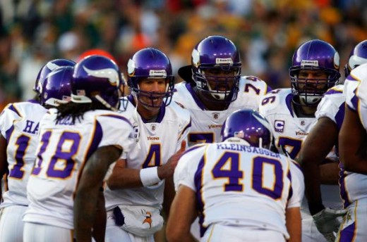 Minnesota Vikings QB Brett Favre (4) huddles with the offensive line the game between the Minnesota Vikings and Green Bay Packers on Sunday, November 1, 2009. (Ben Liebenberg/NFL.com)