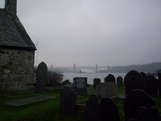 The Britannia railway bridge, seen from Church Island. The roadway running above the rail tubes is clearly visible