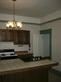 These are not original kitchen cabinets, but it probably was the original location.