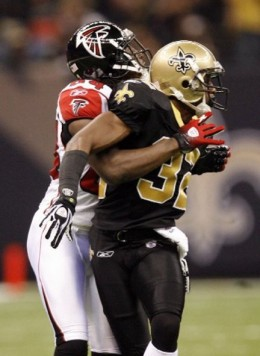 Atlanta Falcons receiver Roddy White prepares to break loose from New Orleans Saints cornerback Jabari Greer for a 68-yard touchdown reception Monday night at the Superdome.