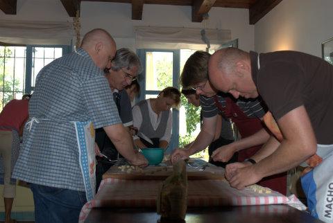 Visitors' at work on Franco's hands on gnocchi making