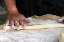 Roll gently a piece of the dough untill it adopts the shape of  a sausage ...