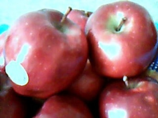 The fiber content of an apple helps regulate bowel movement and may reduce the risk of colon cancer.