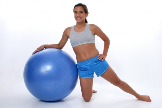 If you can, use a Pilates or Swiss ball to sit on for part of the day. By trying to keep your body on the ball and on your computer will help build stomach muscles.