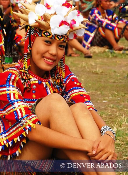 A lady in native costume taking a rest after the street dancing competition.