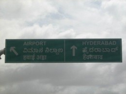 Directions to the Airport. Straight is to Hyderabad and the left arrow indicates the airport direction and to get on to the trumpet flyover.