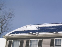 Snow on solar panels can severely reduce electric power output.