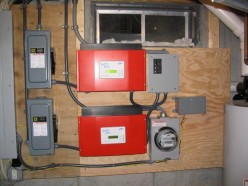 Solar panels are hooked up to your present electric system with interfaces as shown here. The reason for a direct hookup is that you will want excess energy produced from your solar panels to flow out to the network, turning your meter backwards.