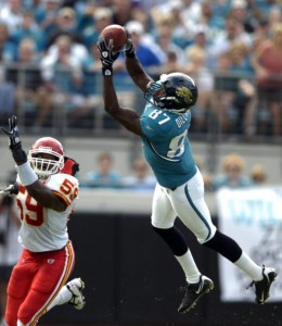 Jacksonville wide receiver Jarett Dillard (87) makes a catch over Kansas City linebacker Jovan Belcher, left, in first quarter game action during an NFL football game, Sunday, Nov. 8, 2009, in Jacksonville, Fla. (AP Photo/Stephen Morton)