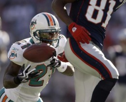 Miami Dolphins cornerback Vontae Davis (21) makes an interception behind New England Patriots wide receiver Randy Moss (81) during the first quarter of their NFL football game in Foxborough, Mass., Sunday, Nov. 8, 2009. (AP Photo/Charles Krupa)