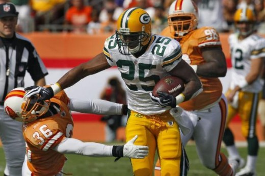 Green Bay Packers running back #25 Ryan Grant stiff-arms Tampa Bay Buccaneers' #36 Tanard Jackson after running past Buccaneers #98 Ryan Simms during the first quarter of an NFL football game Sunday, Nov. 8, 2009, in Tampa, Fla. (AP Photo/Chris O'Mea
