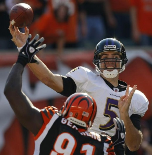 Baltimore Ravens quarterback Joe Flacco (5) passes under pressure from Cincinnati Bengals defensive end Robert Geathers (91) in the first half of an NFL football game, Sunday, Nov. 8, 2009, in Cincinnati. (AP Photo/Ed Reinke)