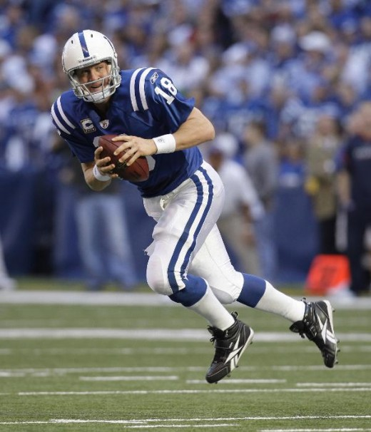 Indianapolis Colts quarterback Peyton Manning looks to pass during the second quarter of an NFL football game against the Houston Texans in Indianapolis, Sunday, Nov. 8, 2009. (AP Photo/Darron Cummings)