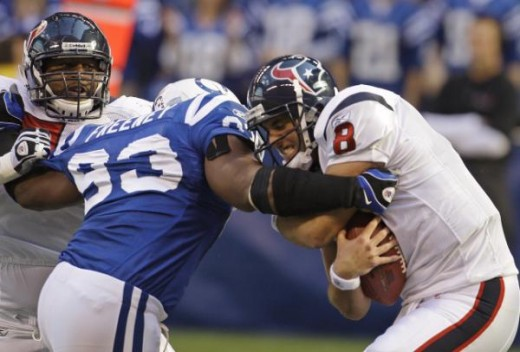 Indianapolis Colts defensive end Dwight Freeney (93) sacks Houston Texans quarterback Matt Schaub (8) during the second quarter of an NFL football game in Indianapolis, Sunday, Nov. 8, 2009. Houston Texans offensive tackle Rashad Butler is at left. (