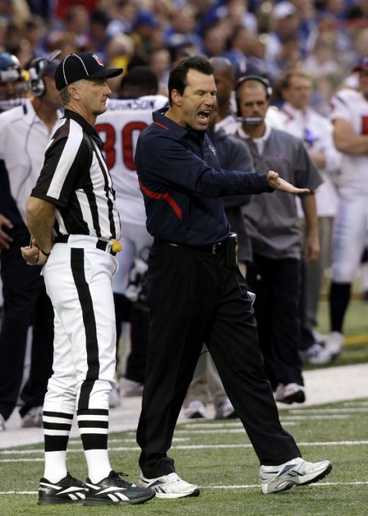 Houston Texans coach Gary Kubiak argues with an official after his team lost a fumble during the second quarter of an NFL Football game against the Indianapolis Colts in Indianapolis, Sunday, Nov. 8, 2009. (AP Photo/Tom Strattman)