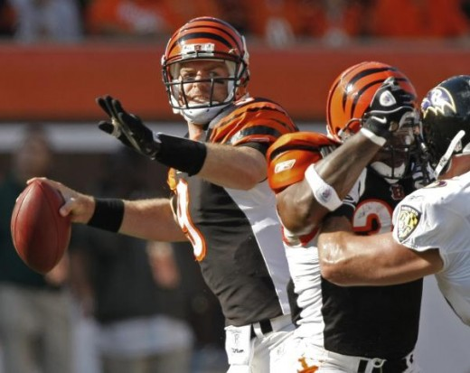 Carson Palmer looks to pass in the first half of an NFL football game against the Baltimore Ravens, Sunday, Nov. 8, 2009, in Cincinnati. Bengals' Cedric Benson (32) blocks Ravens' Jarret Johnson at right. (AP Photo/Ed R