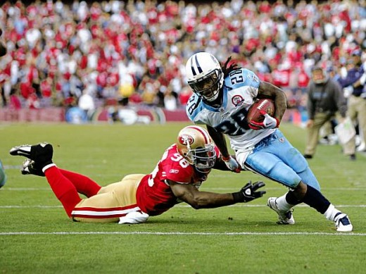Running back Chris Johnson of the Tennessee Titans gets past the 49ers' Parys Haralson on his way to scoring a touchdown. Photo: Ezra Shaw / Getty Images