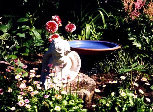 Angel in the border garden.