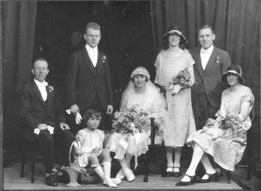 This wedding must have been the height of fashion,with the flapper dresses, and the low brimmed hats.