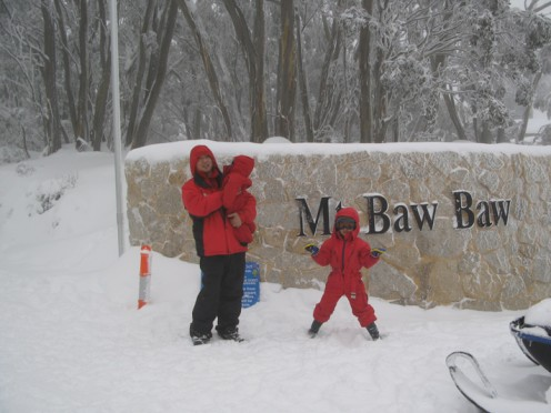 A tourist photographed at the entrance to Mount Baw Baw