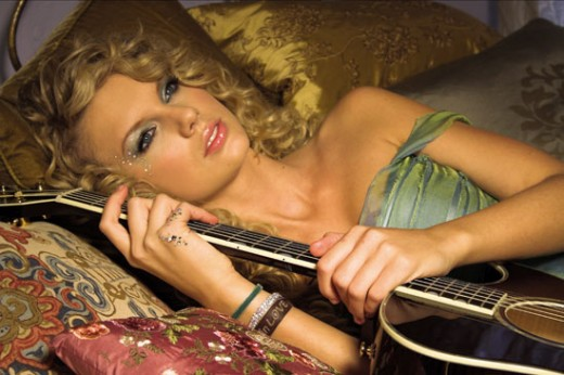 Taylor Swift hugging her beloved guitar