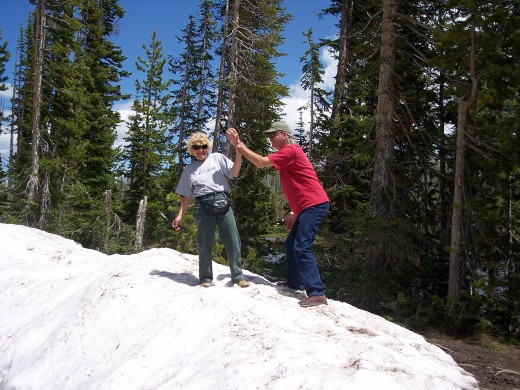 My husband and myself on a snow mound in Yellowstone June 2009