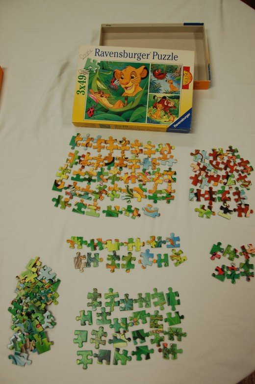 Begin sorting pieces by color, characters or other attributes.