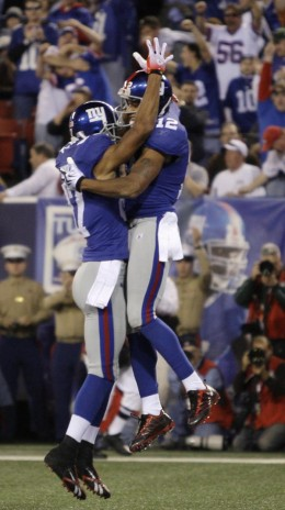New York Giants wide receiver Steve Smith (12) celebrates with fellow receiver Domenik Hixon (87) after catching a pass for a touchdown against the San Diego Chargers in the second quarter of an NFL football game, Sunday, Nov. 8, 2009, in East Ruther