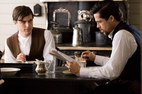 "Robert Ford and Jesse James dining together. Scene from ""The Assassination of Jesse James by the Coward Robert Ford""."