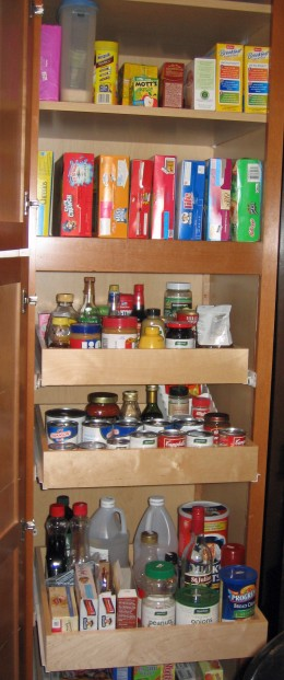 Sliding cabinet shelves in a pantry for easy access.