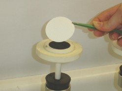 Membrane filter being placed onto magnetic filter funnel base for E. coli filtration and identification by Modified m-TEC methodology.