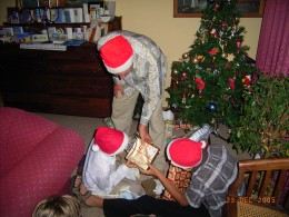 Sharing the presents under our Christmas tree