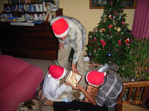 Sharing the presents under our Christmas tree that cost so little but are priceless to us.