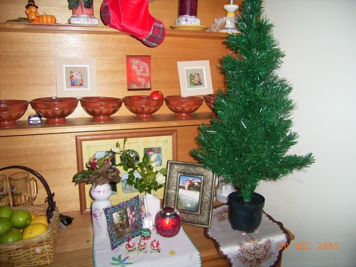 Our family Christmas corner with our deceased ancestors to remember them.
