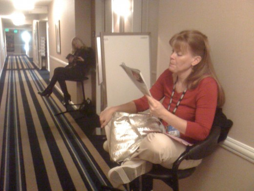 My two teammates, Jana (right) and Heidi (left) make the best of it by reading trade magazines as I did too.