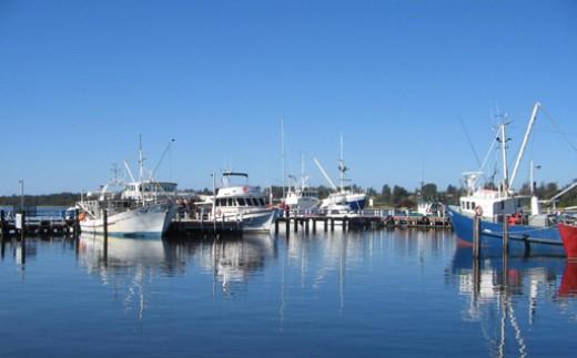 Boats moored at the wharves at Lakes Entrance