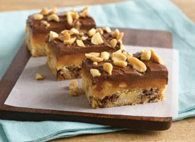 Here is a really delightful recipe for Carmel Peanut Butter Bars that are so delicious